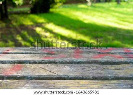 Rustic wood table foreground with natural background out of focus. Selective focus. #1640665981