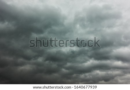 Dramatic sky  -  Gray stormy sky with lots of heavy clouds, may be used as background