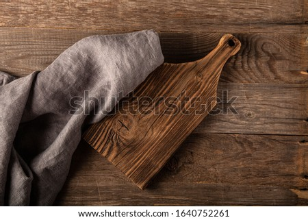 Rustic composition with a rough linen napkin. #1640752261