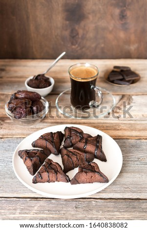 Raw chocolate hamantaschen cookies with coconut on baking tray for Jewish holiday Purim. Dairy free, egg free, gluten free. #1640838082