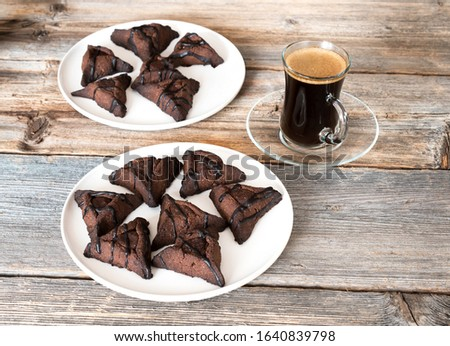 Raw chocolate hamantaschen cookies with coconut on baking tray for Jewish holiday Purim. Dairy free, egg free, gluten free. #1640839798