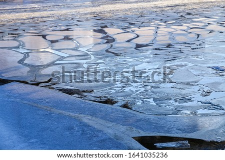 Melting ice floes on the river, snow #1641035236
