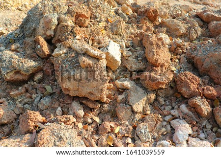 Rocks and soil were excavated from the earth's surface. That can be utilized Such as filling in The deepest parts on various surfaces But not suitable for cultivation Because of this clay color Often #1641039559