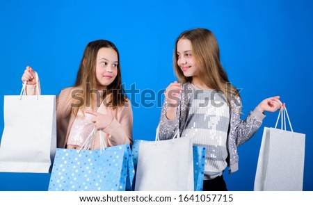 Happy children. Little girl sisters enjoying online shopping. Sales and discounts. Sisterhood and family. savings on purchases. Kid fashion. Small girls with shopping bags. Thanks for your purchase. #1641057715