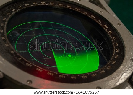 Green military radar screen with unknown target dot - Safety equipment. Royalty-Free Stock Photo #1641095257