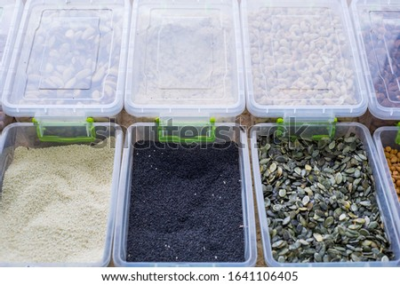 general plan of the store counter, with containers filled with a variety of cereals, cereals. Raw cereals. Healthy nutrition, natural nutrition. diet food #1641106405
