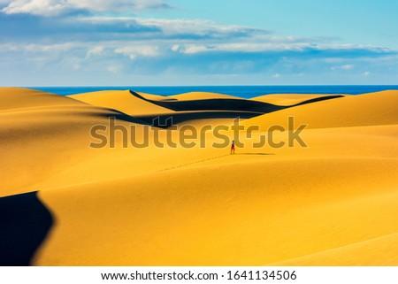 Unrecognizable person jogging in Maspalomas Sand Dunes Gran Canaria Spain #1641134506