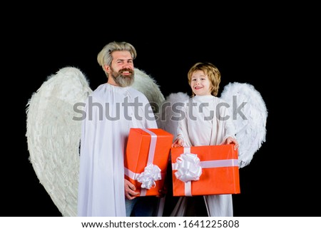 Cute angel. Valentines day. Little angel boy gives father gift. Happy father in angel costume with little son angel holds present. Valentines angels with gift box. Father and son Angels. Father's day. #1641225808