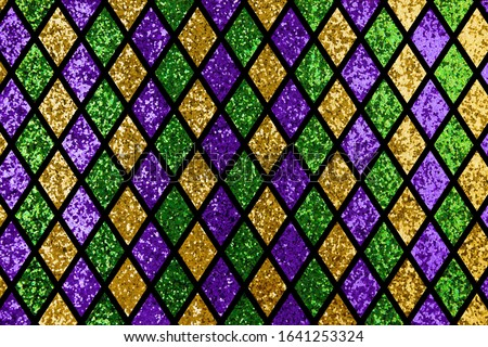 Shiny green, purple and golden glittering paillettes diamonds background pattern fabric with empty space for copy, room for text. Mardi Gras holiday poster backdrop.