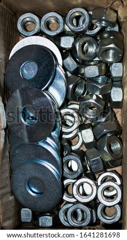 close-up Nuts and washers in box in warehouse #1641281698