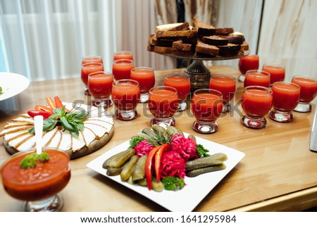 Food for corporate events, parties, conferences, holidays. Cold appetizers and salads on the wedding table. Plate with original appetizer on beautifully decorated table in the restaurant #1641295984