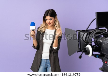Reporter teenager girl holding a microphone and reporting news isolated on purple background making money gesture #1641319759
