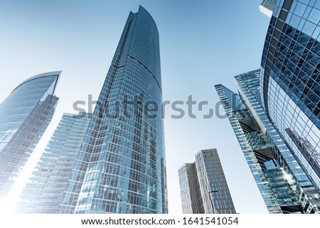 modern skyscraper building in city business downtown urban architecture landmark against blue sky background. Street ground wide view of abstract tower cityscape for backdrop. Futuristic skyscrapers #1641541054