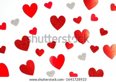 Valentine's day concept. Background from different bright red hearts on a white background. Free space for copying space, flat lay, top view, banner, screensaver. Close-up.