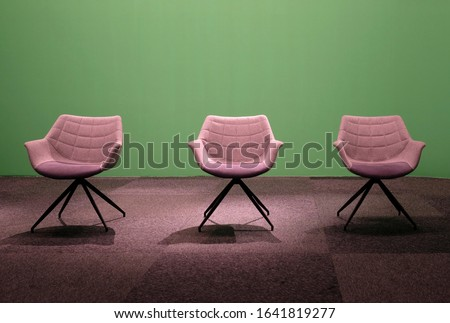 Three empty chairs in a studio with green screen Royalty-Free Stock Photo #1641819277