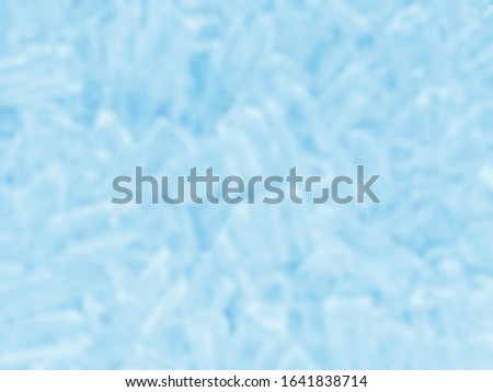 Blurred photo of the Ice cube background in blue shading. #1641838714