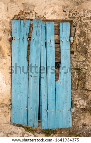 Old cracked blue wooden window in a stone house. Les Baux-de-Provence, Provence, France #1641934375