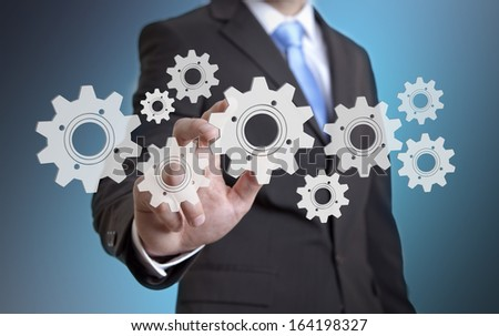 Businessman cogwheel concept #164198327