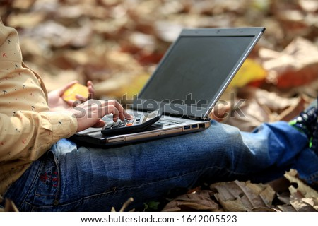 Unrecognizable person calculating with calculator and using laptop. #1642005523