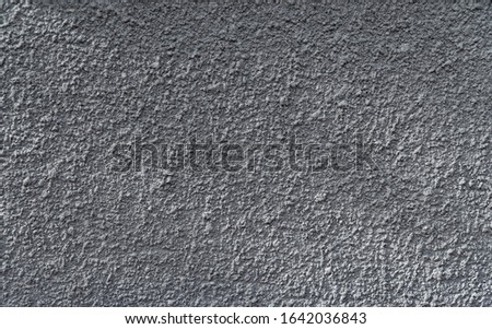 dark gray rough wall texture background with light and shadows well use as editing text present on free space