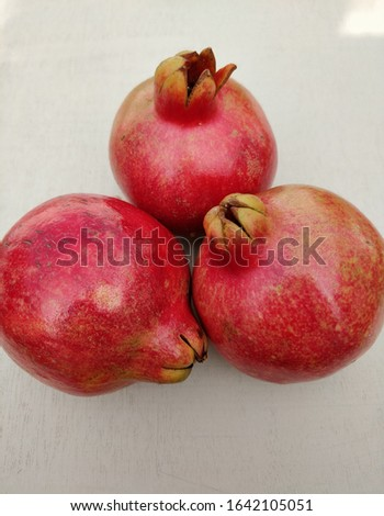 Three fresh and riped pomegranate fruits. Delicious and nutritious. #1642105051