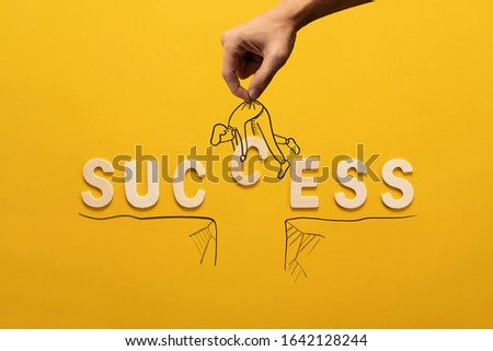 success wooden wording over yellow background in vision and idea conceptual image #1642128244