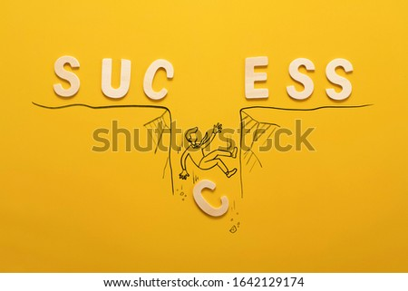 success wooden wording over yellow background in vision and idea conceptual image #1642129174