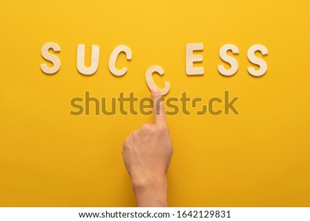 success wooden wording over yellow background in vision and idea conceptual image #1642129831