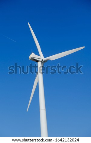 A wind turbine, or alternatively referred to as a wind energy converter, is a device that converts the wind's kinetic energy into electrical energy.  A jet stream enters the picture from the left.