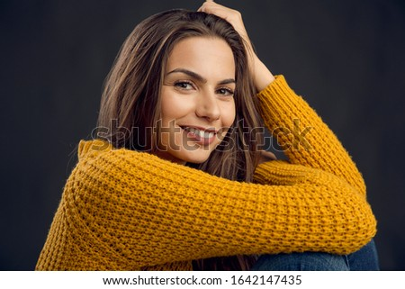 Shot of a beautiful young woman smiling to the camera and smiling #1642147435