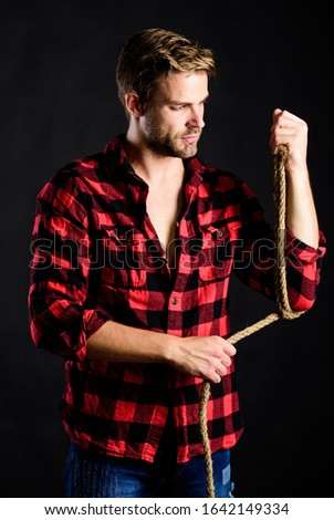 Western life. Masculinity and brutality concept. Adopt cowboy mannerisms as a fashion pose. Man unshaven cowboy black background. Cowboy life came to be highly romanticized. Masculine ideal. #1642149334