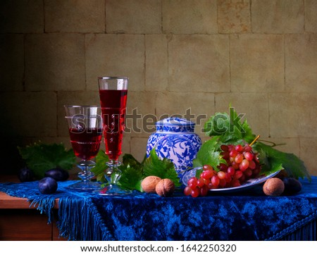 Still life with glasses of  wine and grapes