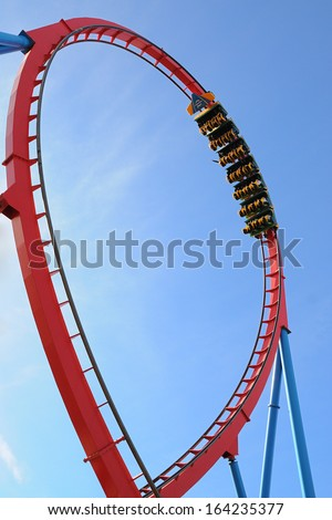 Moving roller coaster with blue sky. Royalty-Free Stock Photo #164235377