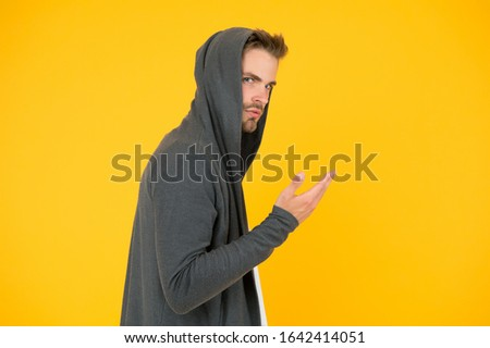 Stay cool. Stylish and attractive guy. Handsome guy in hoodie. Guy wear casual style. Caucasian guy with unshaven face. Bearded man yellow background. Fashion and style. #1642414051