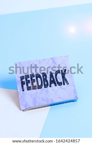 Handwriting text Feedback. Concept meaning information about reactions to product demonstratings perforanalysisce of task Paper placed tilted above buffer wire on soft pastel multi colours backdrop. #1642424857