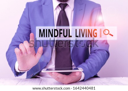 Text sign showing Mindful Living. Conceptual photo Having a sense of purpose and setting goals in life Businessman with pointing finger in front of him. #1642440481