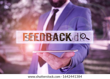 Word writing text Feedback. Business concept for information about reactions to product demonstratings perforanalysisce of task Businessman in blue suite stands with mobile phone in hands. #1642441384
