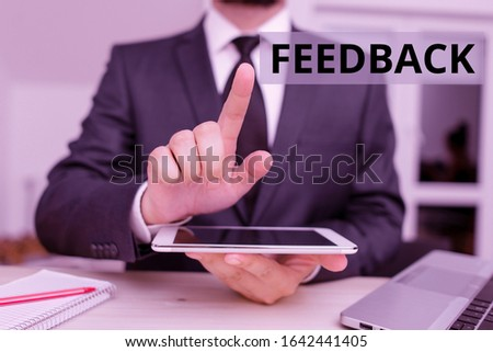 Text sign showing Feedback. Conceptual photo information about reactions to product demonstratings perforanalysisce of task Male human wear formal clothes present presentation use hi tech smartphone. #1642441405