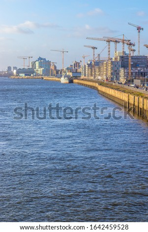 Hafencity construction sites at the Elbe river with a lot of cranes, Hamburg, Germany. Royalty free stock photo.