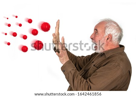 Flu viruses attack. Oversized red flu viruses attack an older man. Many people are afraid of the flu virus. What else can you do to prevent influenza viruses? Royalty-Free Stock Photo #1642461856