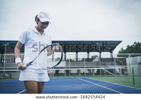 Sport concept; Young people playing tennis on court and relaxing of sport