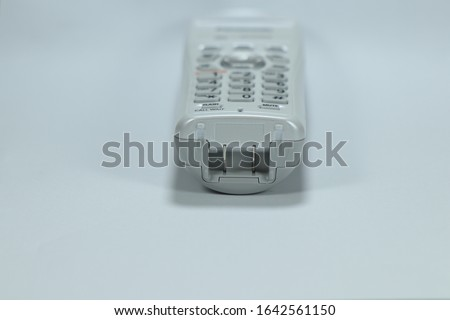 Rechargeable Contact switch charger at the wireless telephone on white background. Old technology of charging electronic device. #1642561150