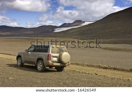 A four by four car parked to observe the magnificent Icelandic Highland scenery of the Sprengisandur Tundra #16426549
