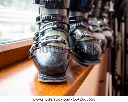 Ski boots rental, skis and poles. Skiing equipment rented. Close up #1642665556