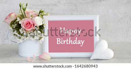Photo frame with the lettering Hapyy Birthday