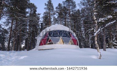 View of aurora domes in a baloon shape ready to see northern lights at daytime Royalty-Free Stock Photo #1642711936