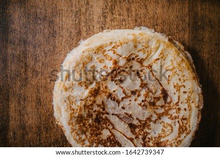 Close-up picture of pancake texture on wooden background