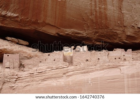 Ancient Anasazi housing atop a cliff in Canyon de Chelly. #1642740376
