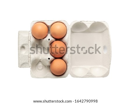 Open egg box with four brown eggs isolated on white background with clipping path. Fresh organic chicken eggs in carton pack or egg container top view #1642790998