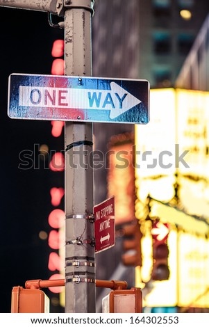 One way New York traffic sign with illuminated and blurred background